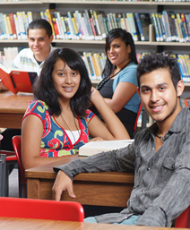 Male and female students in a library.