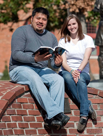 A male student and a female student on the OSU-Tulsa campus.