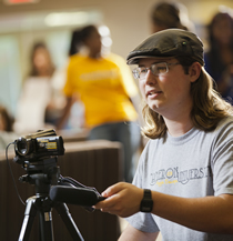 CU student operating video camera