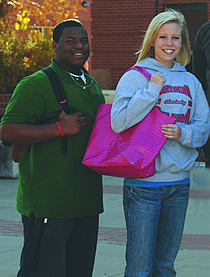 A male NOC student and a female NOC student.