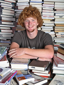 RSU student surrounded by books