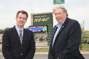 Photo of USAO's electronic marquee, Mayor Greg Elliott and President John Feaver.