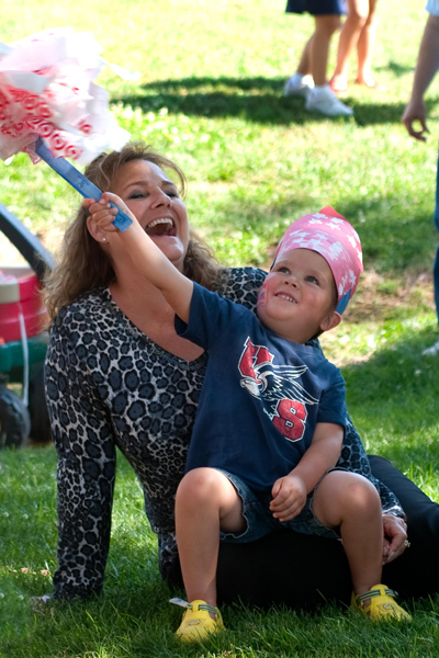 Photo of RSC student Carolyn Ensey and her grandson at 4th of July parade.