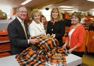 Photo of Burns and Ann Hargis, Paulette Hebert and Judy Barnard with OSU tartan plaid.