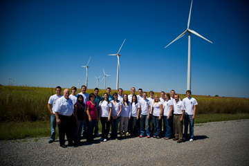 Photo of SWOSU President's Leadership Class with wind turbines.