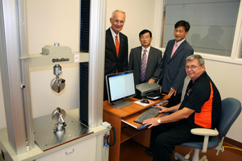 Photo of OSUIT President, OSUIT faculty member and Korean businessmen.