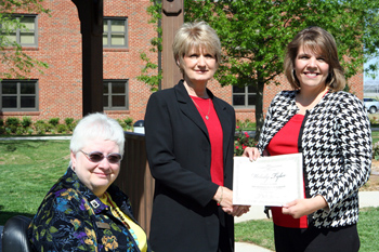 Photo of CU student Melody Tyler, Dr. Robinson and Dr. Vanderslice.