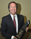 Photo of Regent Bill W. Burgess with award.