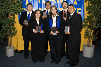 Photo of Rose State College business students with awards.