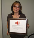 Photo of OSU-OKC's staff member and award.