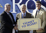 Photo of RSC President presenting a ticket to Rose to Choctaw school superintendent and principal.